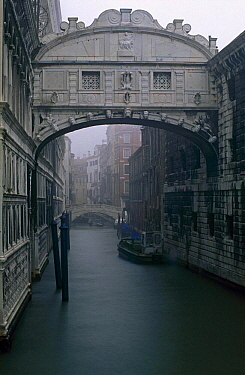 Misty morning over the Bridge of Sighs in St Mark's Square, Venice, Italy. Lord Byron popularised the belief that the bridge's name was inspired by the sighs of condemned prisoners as they were led th...
