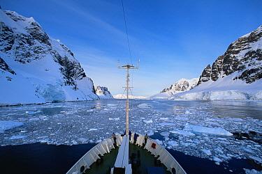 "Bow of expedition cruise ship ""Professor Molvanov"" cruising through the icy Gerlache Strait, Antarctic Peninsula."