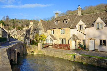 Bridge over the Bybrook river and medieval street in the Cotswolds village of Castle Combe, Wiltshire, UK, November 2017.