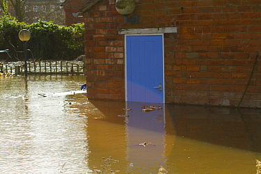 Flooding outside house with blue door during February 2014 floods, Upton upon Severn, Worcestershire, England, UK, 9th February 2014.