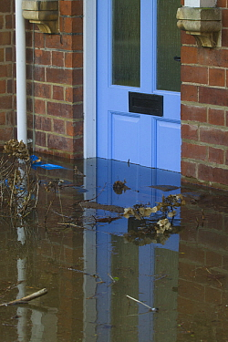 Flooding outside house with debris in front of door during February 2014 floods, Upton upon Severn, Worcestershire, England, UK, 9th February 2014.