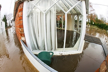 Fish eye view of conservatory of flooded house, showing water inside and outside, during the February 2014 floods, Upton upon Severn, Worcestershire, England, UK, 9th February 2014.