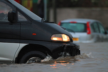Van in floodwaters after sea defences were breached, at Splash Point in Rhyl, Denbighshire, Wales, 5th December 2013.