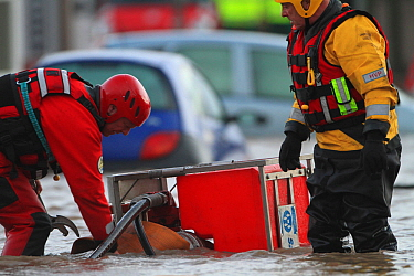 Emergency services pumping floodwaters, after sea defences were breached at Splash Point in Rhyl, Denbighshire, Wales, 5th December 2013.