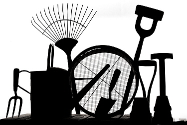 Gardening tools silhouetted on white background.