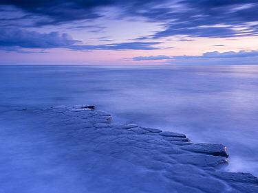 Kimmeridge Bay, ledges at twilight, The Purbecks, Dorset, UK. April.