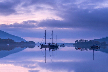 Loch Leven, boats and reflections at dusk, Perthshire, Scotland, UK. November .