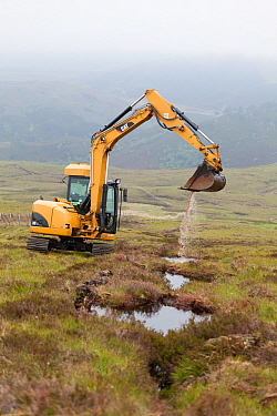Digger creating pools on upland peat moor to retain rainwater and create wetland habitat more suitable for sphagnum moss, Alladale Estate, Sutherland, Scotland, UK., July 2012.