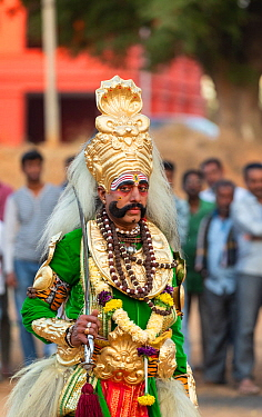 Local man in traditional costume for Veeragase dance Karnataka, India. Pairs of dancers perform to narration of the story of the Daksha yajna. January 2019.