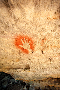 19,000 year-old Aboriginal rock painting of a hand on sandstone, Cania Gorge National Park, Queensland, Australia. September 2016.