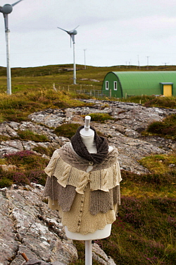 Manequin with high quality knitwear made from sheep grazed on local machair. With wind turbines powering production of wool. North Uist, Scotland, UK, July 2016.