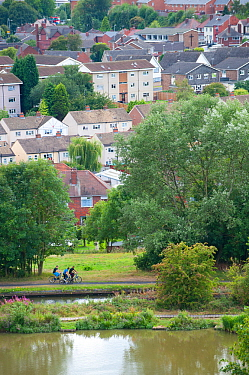 People cycling on towpath near Bumble Hole Nature Reserve, Sandwell, West Midlands, July 2011