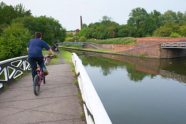 Cycling over canal bridge near Bumble Hole Nature Reserve, Sandwell, West Midlands, July 2011
