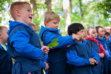 Children from Rowley View Nursery School exploring nature at the Moorcroft Environmental Centre Forest School, Moorcroft Wood, Moxley, Walsall, West Midlands, July 2011.