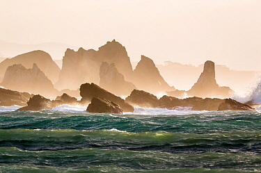 Rocks and sea stacks in the surf at Playa del Silencio in Asturias on the Northwest coast of Spain. May 2015
