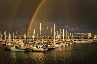 Rainbows over Royal Melbourne Yacht Squadron marina at sunset. Taken from St Kilda breakwater, Melbourne, Victoria, Australia. 2016.