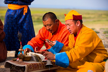 Monks chanting sutras in mountain worshipping ceremony. Great Gobi B Strictly Protected Area, Mongolia. 2018.