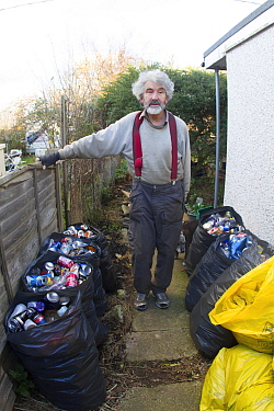 Kevin Whales, man with litter he has picked from street and sorted for recycling. Jaywick, Essex, England, UK.