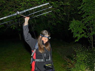 Lucy Bearman-Brown radiotracking a Hedgehog (Erinaceus europaeus) with a transmitter attached, after dark, Hartpury University, Gloucestershire, UK, June 2019. Model released.