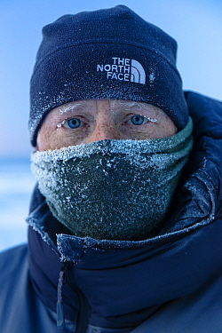 Wildife photographer Ingo Arndt in winter clothing, portrait. Lake Baikal, Siberia, Russia. February 2019.