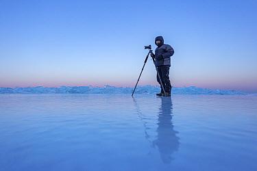 Wildife photographer Ingo Arndt at work on Lake Baikal. Siberia, Russia, February 2019.