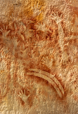 Rock art with stencilled hands and boomerang. The Art Gallery, 62m of rock with 2000 stencils, engravings and paintings. Baloon Cave, Carnarvon Gorge, Carnarvon National Park, Queensland. 2014.