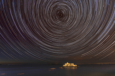 Stars Trails around the North Star, above sea and National Fort, Saint-Malo, Brittany, France.