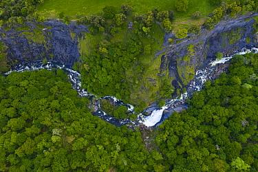 Gandara River waterfall and deciduous woodland. Soba Valley, Valles Pasiegos, Cantabria, Spain. May 2019.
