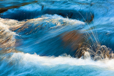 Water flowing out of the Hyalite Resevoir, Hyalite Creek, Gallatin National Forest, Bozeman, Montana, USA. March