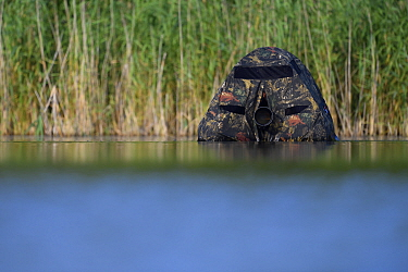 Floating hide with camera lens visible, for photography in the Nemunas Delta Nature Reserve, Lithuania.