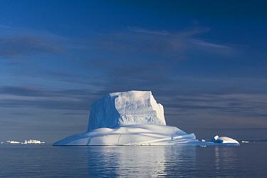 Iceberg in late afternoon light, Northwest Fjord, Scoresby Sund, Greenland, August.