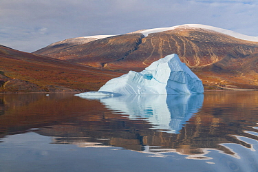 Iceberg and reflection, in Rode Fjord (Red Fjord), Scoresby Sund, Greenland, August.