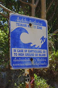 Tsunami warning sign on Maya Beach, Koh Phi Phi, Thailand, an area devastated by 2005 tsunami.