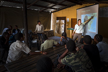 ?Education officer Jane Horgan, from Cheetah Conservation Botswana (CCB), talking to children attending their bush camp in the Kalahari - 30km outside Ghanzi - about where Cheetahs (Acinonyx jubatus)...