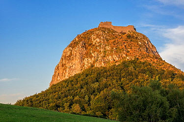 Ruins of the medieval Chateau de Montsegur castle on hilltop at sunset, stronghold of the Cathars, Ariege, Occitanie, France, September 2018