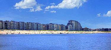 Tourists on the beach and flats and apartments at Nieuport / Nieuwpoort, seaside resort along the North Sea coast, West Flanders, Belgium 2019