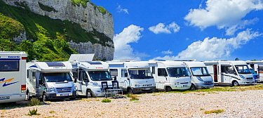 Motorhomes parked along the French coast at Saint-Valery-en-Caux in summer, Seine-Maritime, Normandy, France 2019