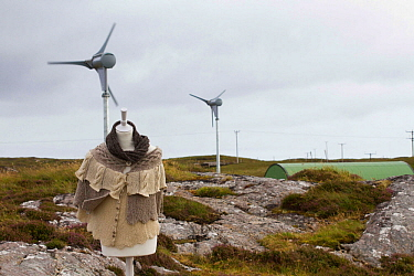 Manequin with knitwear made from sheep on machair with sustainable power wind turbines powering production of wool from machair grazing sheep. North Uist, Outer Hebrides. Scotland, UK, July 2016.