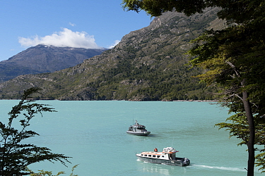 Chilean naval vessel and tourist boat on O'Higgens Lake, at Candelario Mancillo, Chile. January 2017.