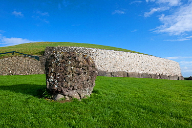 Newgrange, Neolithic passage tomb dated to 3 200 BC, white quartz cobblestone revetment and kerbstones, World Heritage Site, County Meath, Ireland. October 2019.