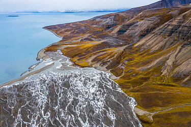 Aerial view of eroded mountain slopes at coast and rich network of river channels. Billefjorden, Skansbukta, Svalbard, Norway
