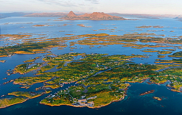 Aerial view of islands, islets and skerries, scattered in a wide strandflat. Sleneset, Helgeland Archipelago, Norway. July.