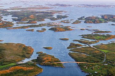 Aerial view of islands, islets and skerries, scattered in a wide strandflat. Heroy, Helgeland Archipelago, Norway. July.