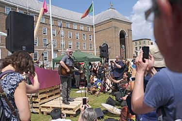 Campaigner Billy Bragg singing at Extinction Rebellion rally. Bristol, England, UK. 16 July 2019.