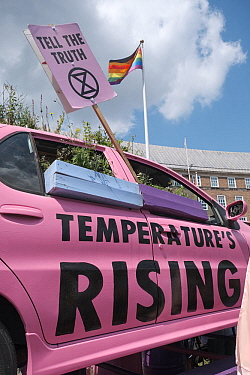 'Tell the truth' placard and pink car with 'Temperature's rising' message. Extinction Rebellion protest. Bristol, England, UK. 16 July 2019.