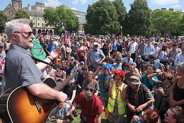 Campaigner and singer Billy Bragg addressing demonstrators at Extinction Rebellion rally. Bristol, England, UK. 16 July 2019.