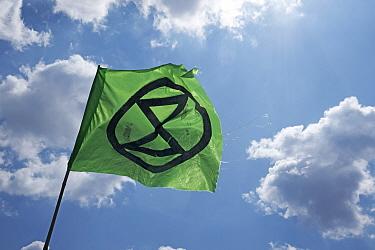 Extinction Rebellion flag flying during climate change protest rally. Bristol, England, UK. 16 July 2019.