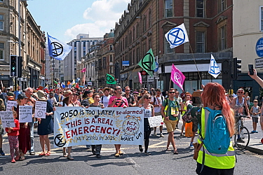 Extinction Rebellion climate change protesters marching through city centre. Baldwin Street, Bristol, England, UK. 16 July 2019.