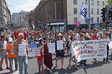 Extinction Rebellion climate change protesters marching through city centre. Bristol, England, UK. 16 July 2019.