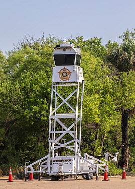 Police tower for law enforcement near the USA-Mexico border. Santa Ana National Wildlife Refuge, near Alamo, Hidalgo County, Texas, USA. July 2019.